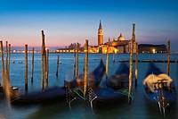 Sunrise over San Giorgio Maggiore with gondolas in the foreground, Venice, Italy, Europe