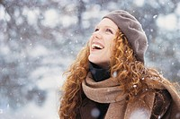 Woman Gazing up at Falling Snow