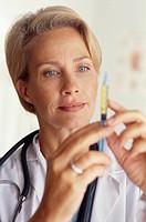 Doctor Testing Syringe