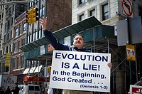 A religious zealot proselytizes against the theory of evolution in New York