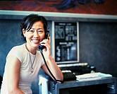 Salon Owner Speaking on Telephone