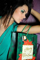a woman with a bag merry Christmas