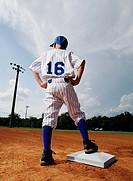 Young Baseball Player Waiting on Base