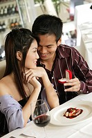Man Proposing to Woman over Dessert