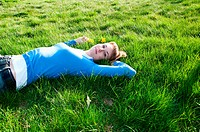 beautiful girl lying on the grass