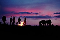 Cowboys around a campfire