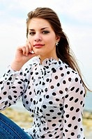 girl wearing spotted blouse