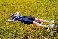 Woman resting on the grass, Villagordo del Jucar, Albacete, Castilla-La Mancha, Spain