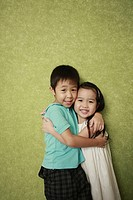 Boy and girl hugging and smiling