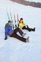Man and woman resting after skiing