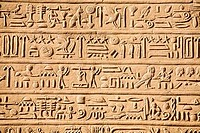 Egypt, Hieroglyphics carved into wall of Temple of Horus and Sobek at ancient ruins of Kom Ombo on Nile River