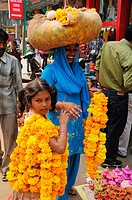 Mother and daughter selling flowers for Diwali festival