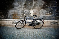 Vintage bicycle parked on cobbled street