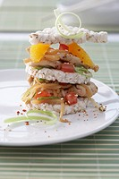 A tower of rice cakes, oranges and vegetables