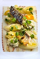 Warm fish salad with smoked eel and mackerel, leek and a mustard dressing