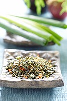 Dried herbs in a stone bowl