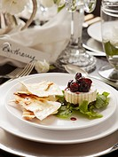 Brie with cranberry sauce and unleavened bread