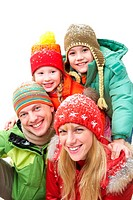Happy family in winter clothes looking at camera and smiling