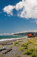 Scenic view of Kachemak Bay and businesses along the Homer boardwalk and beach, Kenai Peninsula, Southcentral Alaska, Summer