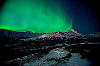 The Northern Lights over Wolverine Peak in the Chugach State Park near Powerline Pass, Anchorage, Southcentral Alaska, Winter