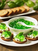 Bread topped with cream cheese and basil jelly