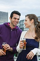 Germany, Berlin, Couple drinking beverages