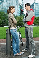 Germany, Berlin, Couple standing face to face in park