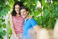 Germany, Bavaria, Couple in garden, smiling, portrait