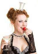 Girl with strawberry and glass of vermuth/