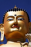 The face of the Golden Buddha statue at Likir Gompa, buddhist monastery, in Ladakh, India
