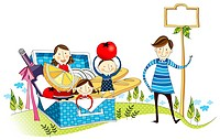 Family enjoying basket dinner at picnic