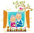 Elderly couple drinking cup of tea beside window