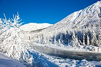 Snow covered landscape along the East Fork of the Six Mile Creek on the Kenai Peninsula in the Chugach National Forest. Kenai Mountains in the backgro...