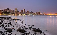 City lights at twilight with debris strewn beach in foreground, Durban, Kwazulu Natal, South Africa