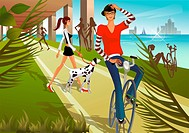 Woman walking with dog with another woman riding bicycle