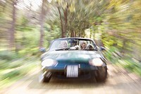 Blurred view of convertible on dirt path