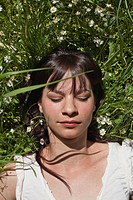 Woman asleep in tall grass