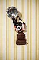 Old_fashioned camera on striped background