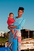 Portrait of mother carrying baby, Missionvale, Eastern Cape Province, Port Elizabeth, South Africa