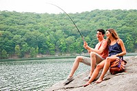 Young couple fishing at lake (thumbnail)
