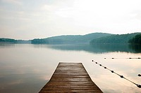 Pier onto calm lake, Bear Mountain, NY, USA