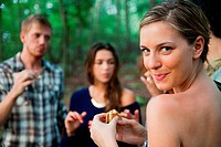 Young woman enjoying food in forest