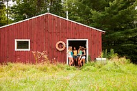 Teenage girls in door way of boat house during summer vacation