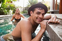 Couple relaxing in hotel swimming pool