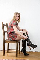 blond girl wearing short red dress sitting on chair zip up