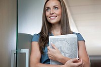 Portrait of businesswoman holding papers