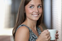 Portrait of woman holding coffee cup