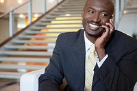 Portrait of smiling businessman talking on cell phone