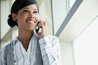 Portrait of smiling businesswoman talking on cell phone