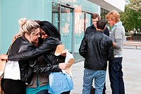 University students embracing on exam results day